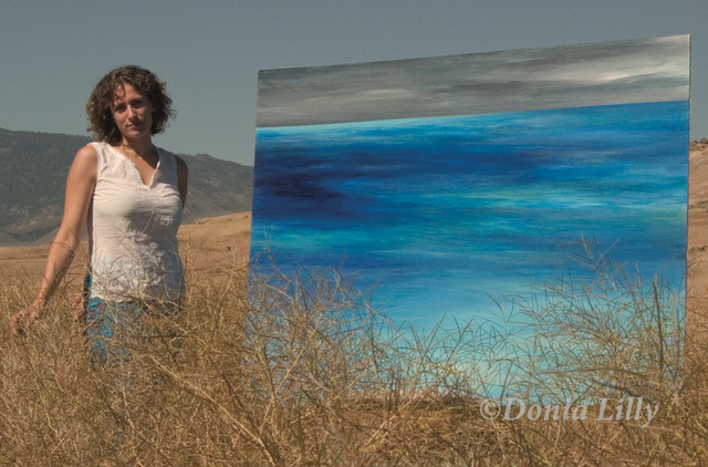 photo of large ocean acrylic painting aqua blue grey with Kauai artist Donia Lilly