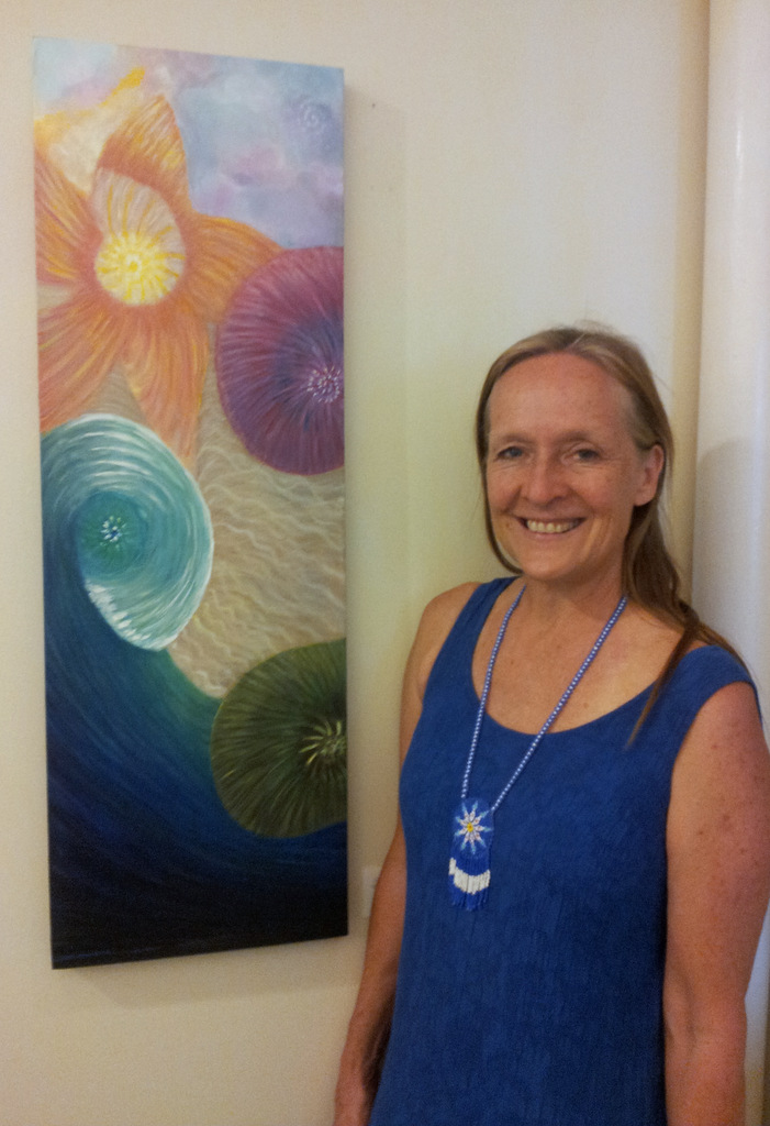 Carol Diane Bevis with her rainbow sea painting