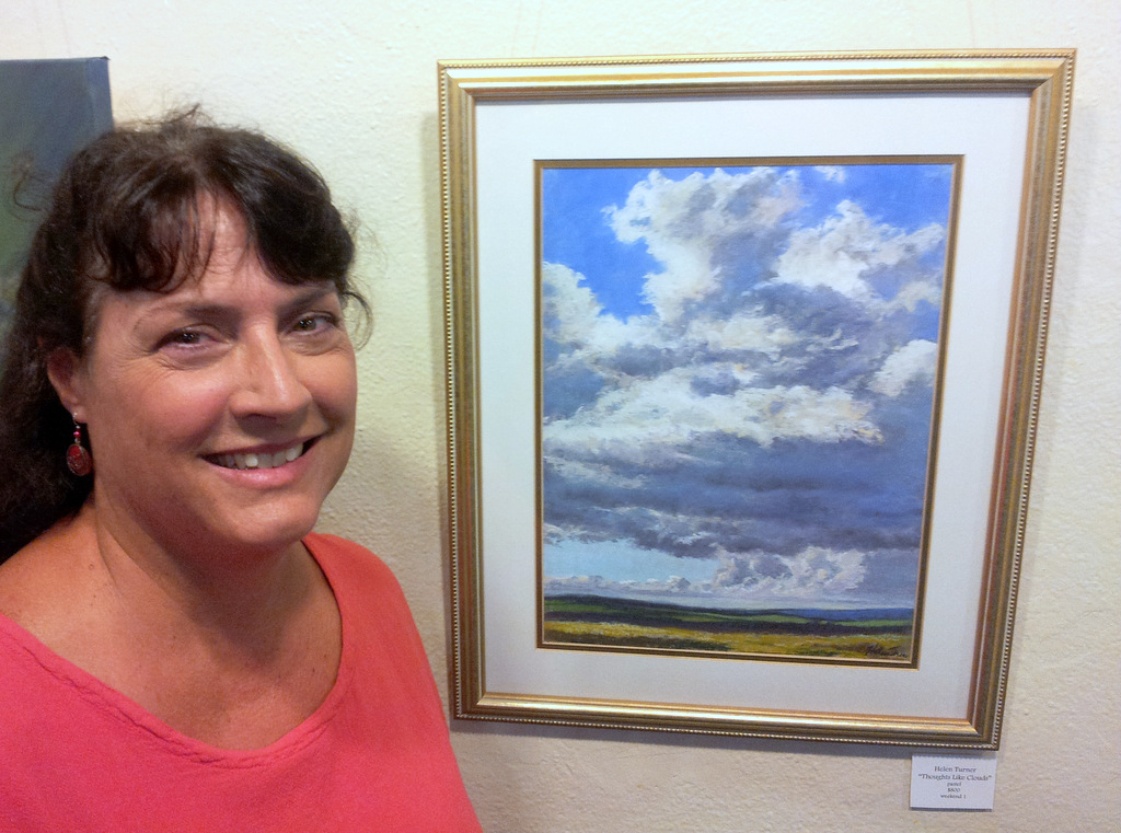 Helen Turner with her soft pastel landscape painting at Women Artists of Kauai Museum opening