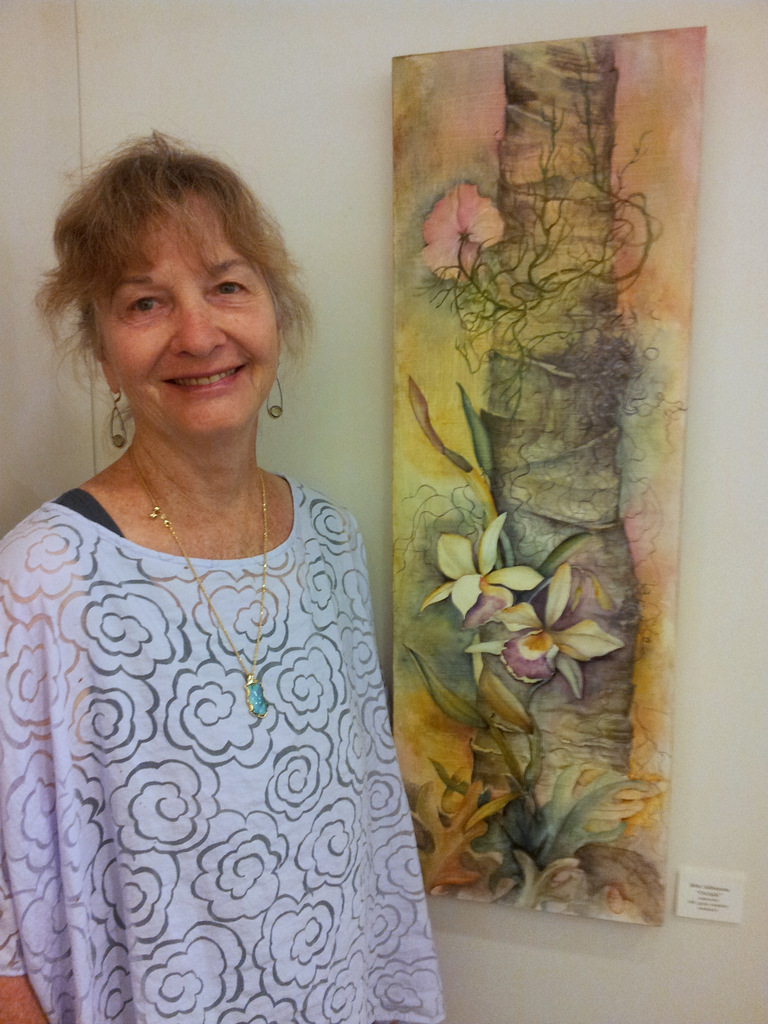 Ibbie Alshamma with her orchids watercolor at Women Artists of Kauai Museum opening