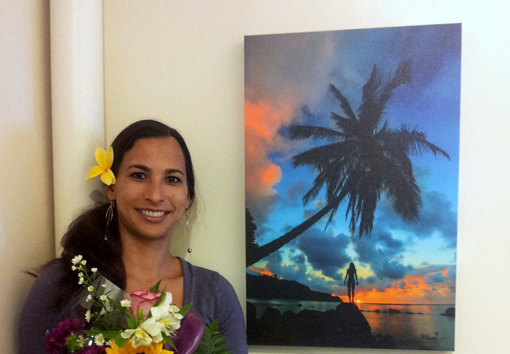 Keani Andrade with her self-portrait photograph at Women Artists of Kauai Museum opening
