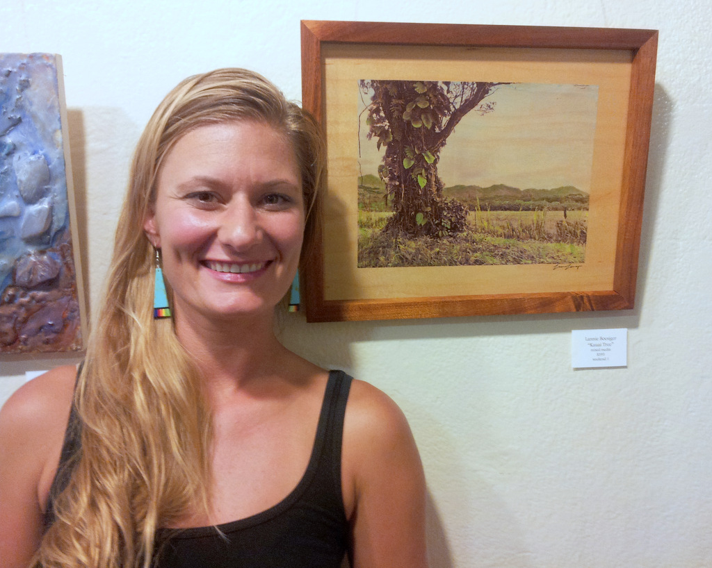 Lannie Boesiger with her hand painted photograph at Women Artists of Kauai Museum opening