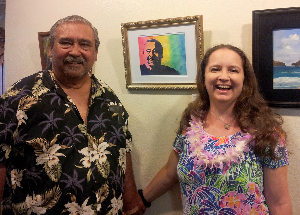 Marionette and Joe Taboniar with her portrait of Joe at Women Artists of Kauai Museum opening